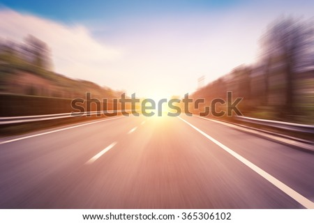 blured road with sun - stock photo