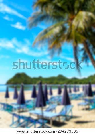 Blured view of deckchairs and beach umbrellas - stock photo