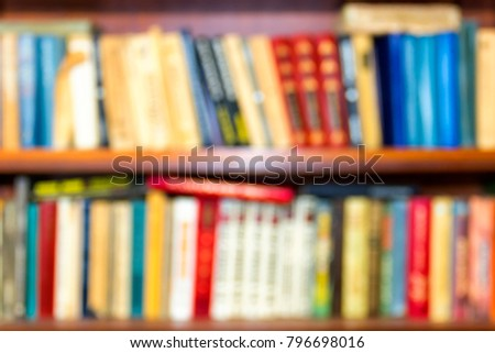 Blurred abstract background from books on shelves.