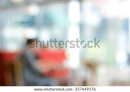 Blurred abstract background from image of people sitting in coffee shop - stock photo