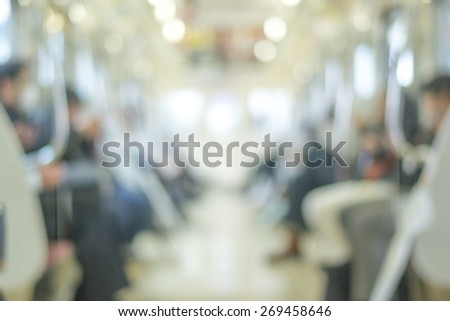 Blurred abstract background in vintage style of people commuting on Tokyo subway train - stock photo