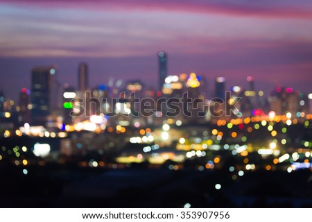 Blurred abstract background lights, beautiful cityscape view at sunset. - stock photo