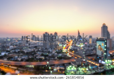 Blurred abstract background lights, beautiful cityscape view, at twilight. - stock photo