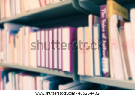 Blurred abstract background of book shelves row and interior of college library with textbooks, literature, menuscript, thesis and magazines. - Vintage Tone