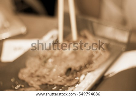 Blurred abstract background of Chopsticks with meat