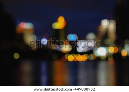 Blurred abstract background of city night lights downtown city and lake view.   - stock photo