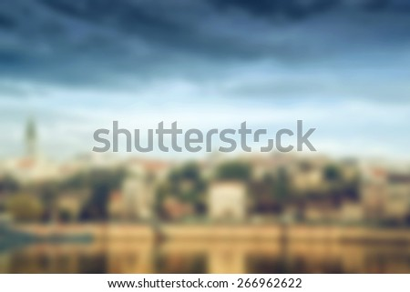 Blurred abstract background of cityscape, building over the river - stock photo