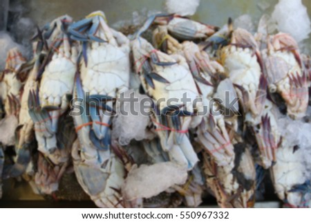 Blurred abstract background of crab seafood sell in supermarket.