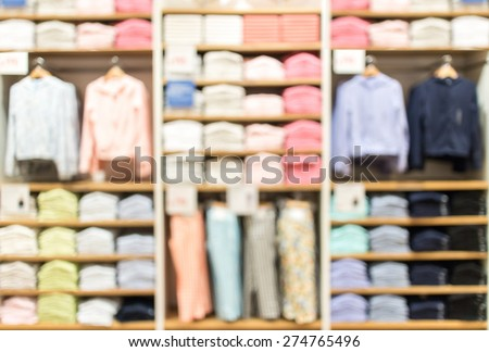 blurred abstract  background of multicolored cotton clothing on the shelves of fashion shop. - stock photo