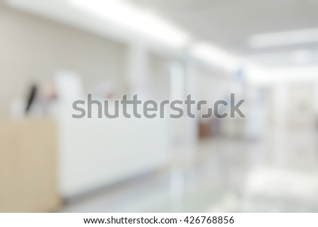 Blurred abstract background of nurse station in from of doctor room with corridor.Blur view OPD - out patient clinic department: Blurry view clinical indoor space in hospital. - stock photo