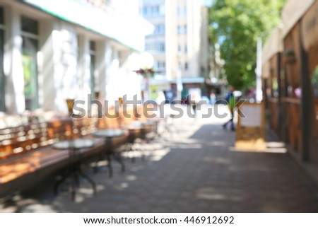 Blurred abstract background of outdoor cafe - stock photo