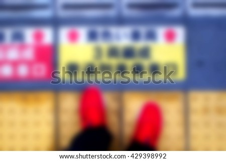 Blurred abstract background of People standing red shoes