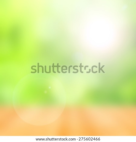 blurred abstract green bokeh background with flare - stock photo