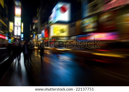 Blurred abstract shot of Times Square in New York at night - stock photo