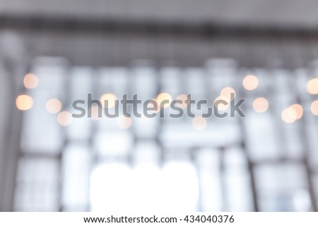 Blurred abstract window wall background interior view looking out toward to empty office lobby. - stock photo