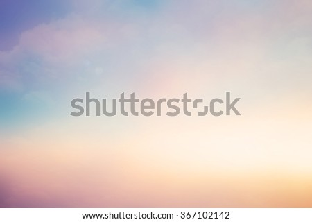 blurred art beautiful natural landscape background with ray flare lights.blurry sunshine wallpaper concept.backdrop pastel tone.idyllic shores sundown hours.abstract dream magic coastline dramatic. - stock photo