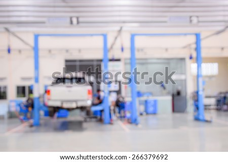 Blurred Auto Repair & Auto maintenance services for background. - stock photo