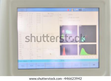 Blurred automate analyzer technology in laboratory. - stock photo