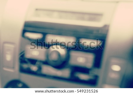 Blurred  background abstract and can be illustration to article of hand adjusting the sound volume in the car stereo