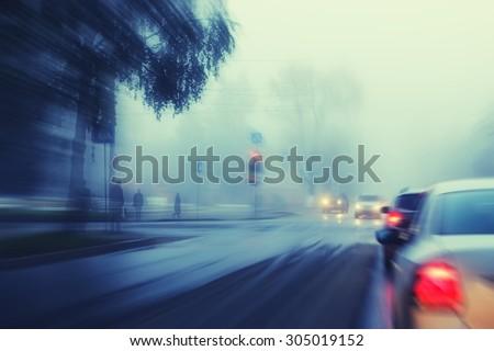 blurred background autumn fog on city road - stock photo