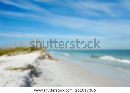 Blurred Background Beach Image of the Beautiful Sand Dunes and Sea Oats on the Coastline of Anna Maria Island, Florida - stock photo