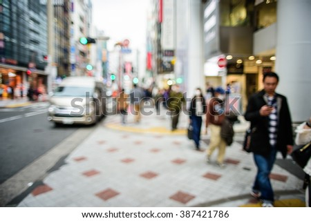 Blurred background. Blurred people walking through a city street. - stock photo