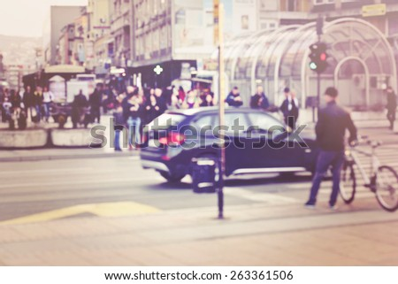 Blurred background. Blurred people walking through a city street. Vintage toned photo. - stock photo