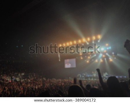 Blurred background : Bokeh lighting in indoor concert with cheering audience, hands up