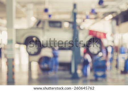 Blurred background : Car technician repairing the car in garage vintage color - stock photo