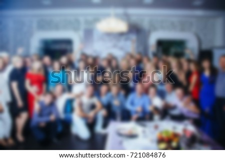Blurred background. Group photo of people in the room