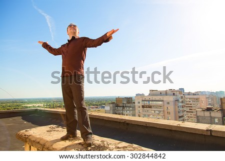 Blurred background image for a man in open space. Man on the background of the city and sunset. Lifestyle, enjoy life, enjoyment, freedom happy man enjoying nature. Male over sky and sun. Joy man. - stock photo