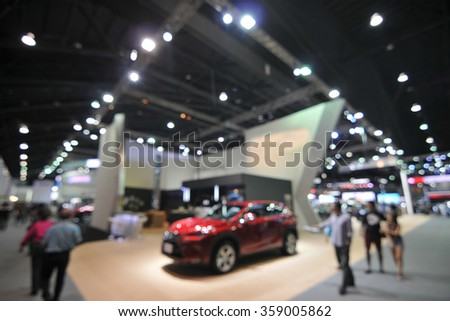 blurred background - motor show - stock photo