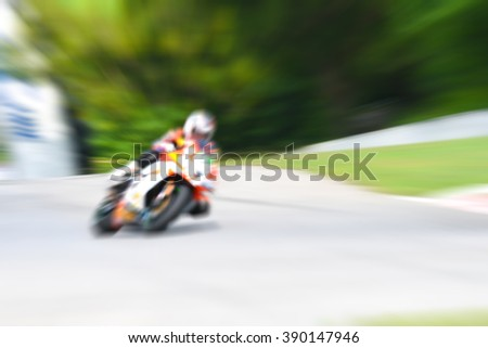 blurred background - motorcycle racing  motion blur - stock photo