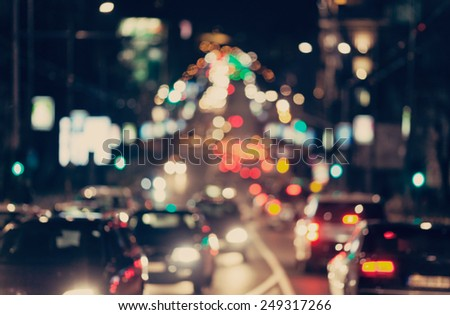 Blurred background. Night city lights blur. Retro toned photo, vintage. - stock photo