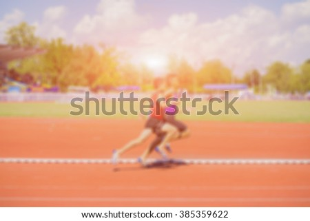 Blurred background of  a man running a race,vintage color. - stock photo