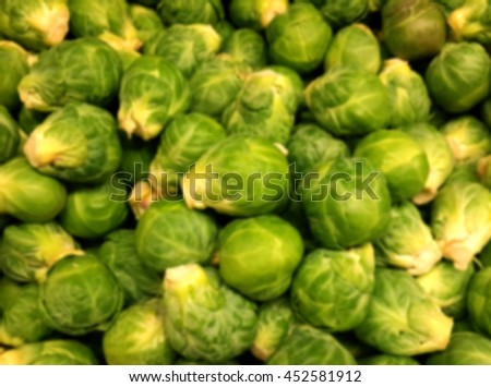 Blurred background of a pile of Brussels sprouts.