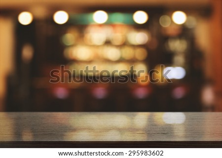 blurred background of bar and black desk space  - stock photo