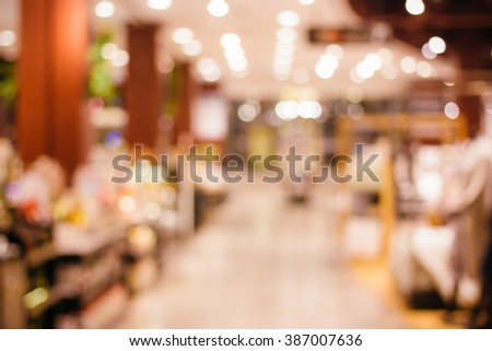 Blurred background of colorful and freshness modern retail , department store or shopping mall with natural bokeh light. For your outstanding retail background and business project design.  - stock photo