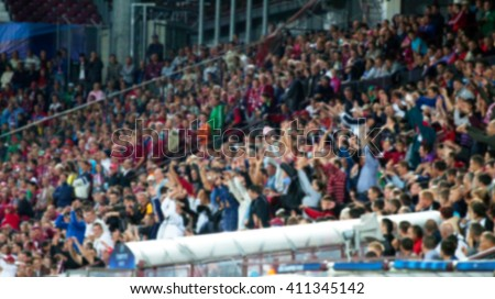 Blurred background of crowd of people at the soccer stadium - stock photo