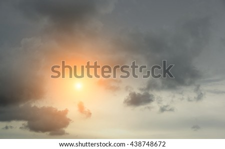 blurred background of dark clouds and sky with sunlight
