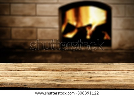 blurred background of fireplace and desk top of wood space  - stock photo