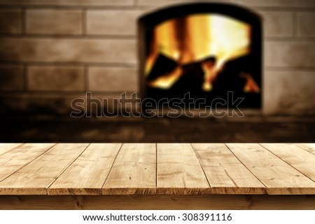 blurred background of fireplace and yellow table place  - stock photo