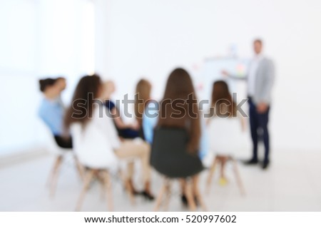 Blurred background of group of people at business presentation