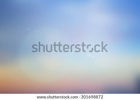 blurred background of lake with lens flare lights.abstract peaceful tranquil pacific ocean backdrop concept:summer coastline warm tone color of sunset sky landscape.blur nature beach pastel texture - stock photo