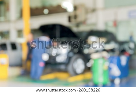 Blurred background of maintenance cars center - stock photo