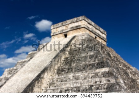 Blurred background of Mayan Pyramid to Kukulkan, the feathered serpent god, at Chichen Itza, Yucatan, Mexico. - stock photo