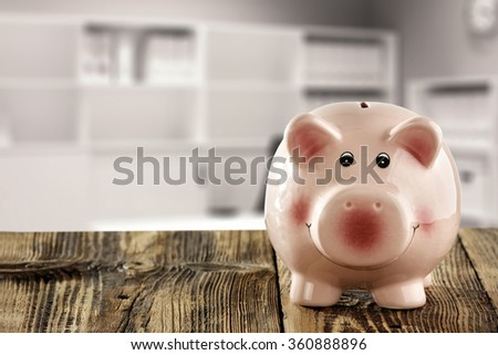blurred background of office and free space with pink bank of pig