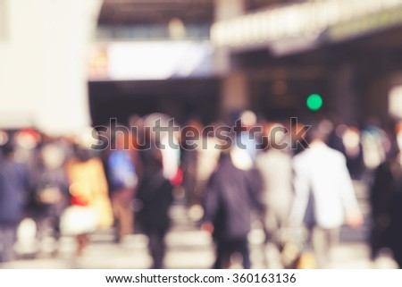 blurred background of people crossing street - stock photo