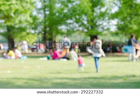 Blurred background of people in park, spring and summer season - stock photo