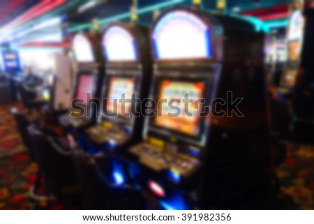 blurred background of slot machines in casino
